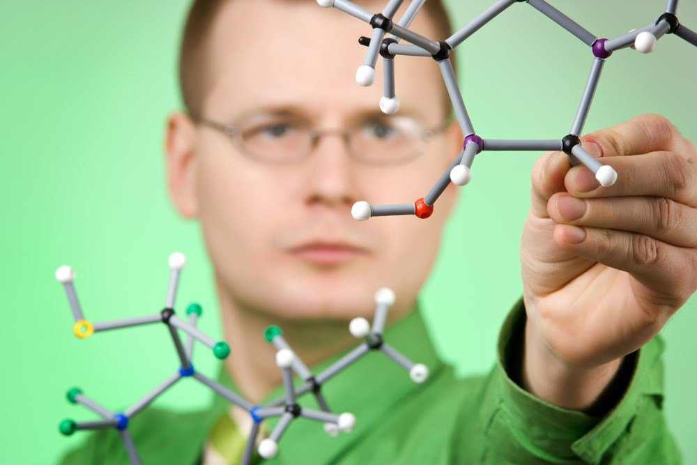 guy with molecular model.jpg